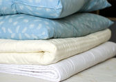 Blankets and feather pillows — Stock Photo