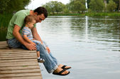 Father and son at the river — Stock Photo