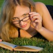 Woman reading book - Stock Photo