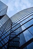 Glass front of office tower — Stock Photo