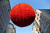 Streets are decorated with red christmas bauble ornaments — Stock Photo