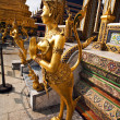 A kinaree, a mythology figure, in the Grand Palace in Bangkok - Stock Photo