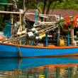 Huts and colorful  fisherboats at the mangrove everglades - Stock Photo