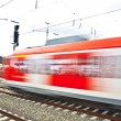 Red train in motion in the station — Lizenzfreies Foto