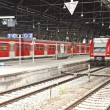Iron classicistic train station from inside with red trains - Foto Stock