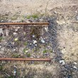 Stock Photo: Ending rusty rails