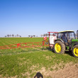 Tractor on field sputtering pest protection — Stock Photo