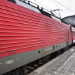 Red train leaves the station — Stock Photo