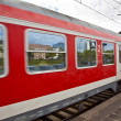 Red train leaves the station — Foto Stock