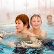 Brothers are swimming in the thermal pool in winter — Stock Photo