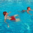 Children having fun in the pool — Stock Photo