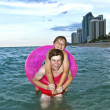 Brothers in a swim ring have fun in the ocean — Stock Photo #5526425