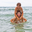 Brothers having fun together in the beautiful ocean — Stock Photo #5526447