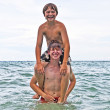 Brothers having fun together in the beautiful ocean — Stock Photo #5526455