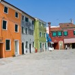 Beautiful colored houses of the old fishermans  city Burano - Stock Photo