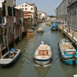 Stock Photo: Beautiful colored houses and boats at canal