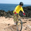 Young boy with mountain bike on tour — Stock Photo