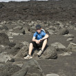 Boy on walking trail thru volcanic area in Lanzarote - Stock Photo