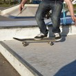 Boy with scateboard is going airborne — ストック写真