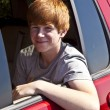 Smiling boy in the rear of the car - Stock fotografie