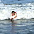 Young boy is body surfing in the beaufiful waves — Foto de Stock