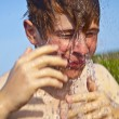 Boy has a shower at the beach - Stock Photo