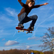 Stock Photo: Boy is jumping with his skateboard