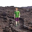Boy walking in volcanic area — Foto Stock