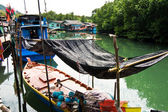 Fish will be dried in a fisherboat in a small fishermans village — Stock Photo