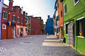 Colorful facade of an old fisher house and street in the village of Burano — Stock Photo
