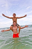Brothers having fun together in the beautiful ocean — Stock Photo