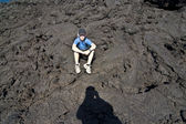 Boy on walking trail thru volcanic area in Lanzarote — Stock Photo
