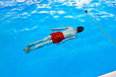 Boy diving in the pool — Stock Photo