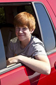 Smiling boy in the rear of the car — Stock Photo