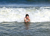 Young boy is body surfing in the beaufiful waves — Stock Photo