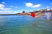 Boy has fun in the clear sea — Stock Photo