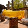 Lying Buddha dressed in yellow scarf in temple Wat Yai Chai-mong - Stock fotografie