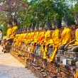 Buddha statues at the temple of Wat Yai Chai Mongkol in Ayutthay - Stock Photo