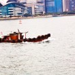 Landscape of Victoria Harbor in Hong Kong with junk boat on the — Foto de Stock