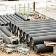 Tubes at a building lot for water supply — Stock Photo