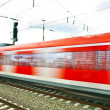 Train leaves the station with speed — Stock Photo #5534536