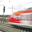 Train leaves the station with speed — Stock Photo #5534542