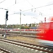 Train leaves the station with speed — Stock Photo #5534549