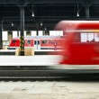 Train leaves the station with speed — Stock Photo #5534554