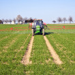 Tractor on field sputtering pest protection — Stockfoto