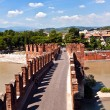 Old bridge in Verona over Adige river - Castelvecchio - Stock Photo