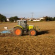 Stock Photo: Tractor plowing the field
