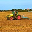 Tractor plowing the field — Stock Photo #5535812