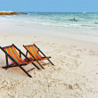 Canvas chair at the beach - Stock Photo
