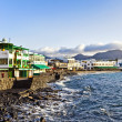 Royalty-Free Stock Photo: Promenade of scenic Playa Blanca with seaside in the morning